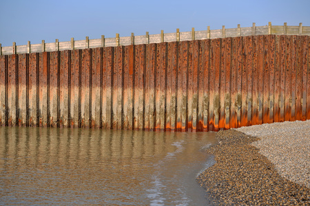 Rusty metal sea wall in Seaford, East Sussex Stock Photo