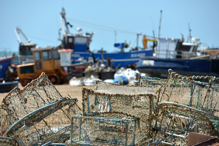 Old fishing nets and lobster pots on Hastings Beach, East Sussex. Stock Photo