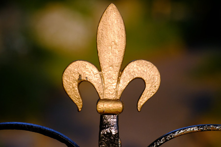 Golden fleur de lys railing finial detail