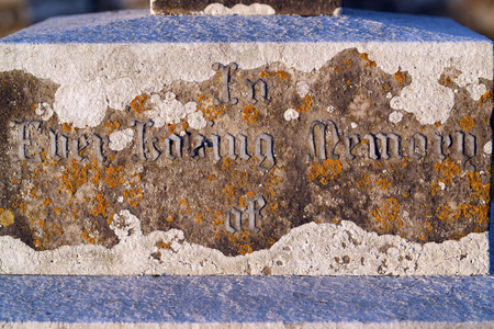 Old leaded gravestone inscribed with In Loving Memory