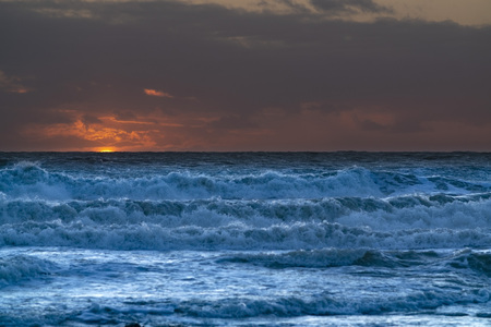 Rough seas and waves at sun set