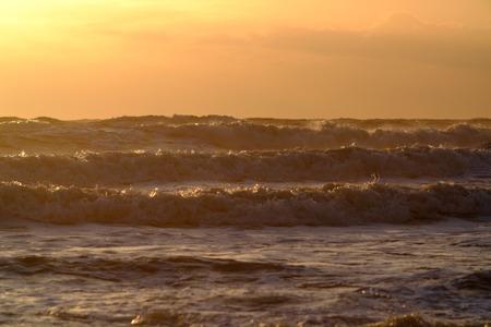 Rough seas and waves at sun set