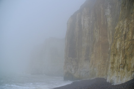 Chalk cliffs shouded in sea minst, Newhaven, East Sussex