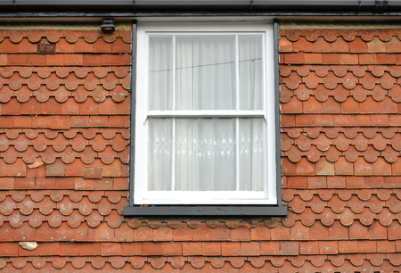Sash window in a tile hing house, Lewes, east Sussex, Uk