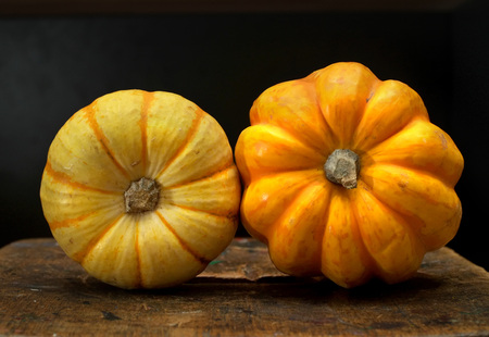 Small pumpkin or squash on a wooden board. Stock Photo