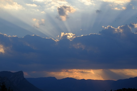 Clouds and sun rays at sunset, Spain, Stock Photo