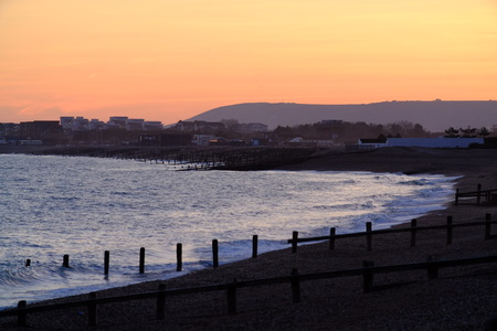 Shingle beach at Pevensey Bay, East Sussex, at sunset