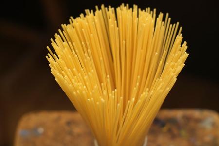 Dry pata, spaghetti, in a white pot