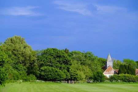 Small village church in a country landscape Stock Photo