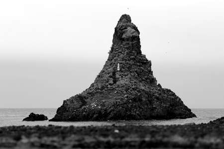 This photo shows one of the stacks of Acitrezza, famous place in Sicily for the matches with city of Ulysses and the locations of the novels of Giovanni Verga Reklamní fotografie