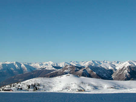 Panoramic view of Alps mountains covered of snow in wintertime, Italy Stock Photo