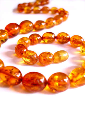 Closeup of an amber necklace on white background Stock Photo