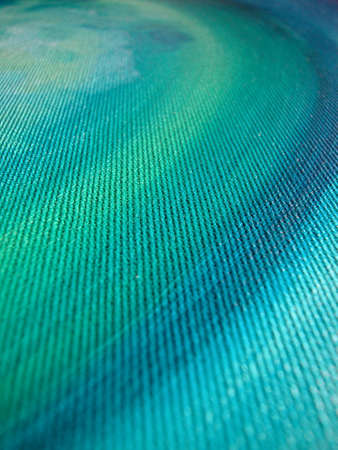 Macro of blue and green waves of oil on canvas colours photo