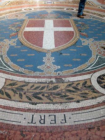Walking on mosaic in gallery Vittorio Emanuele II in Milan, Italy photo