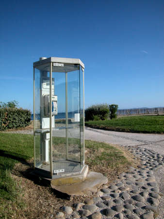 telephone booth: Public phone cabin by the sea, France