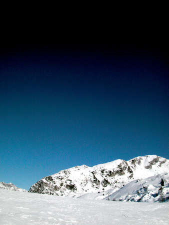 ski area: Panoramic view of Alps mountains covered of snow in wintertime, Italy Stock Photo