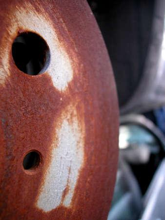 deteriorate: Closeup of metal rusted car parts, focus on detail