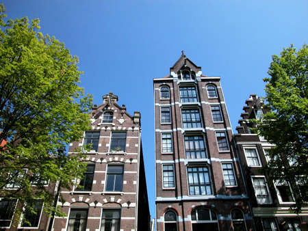 Ancient houses in Amsterdam, view from the canal, Netherlands