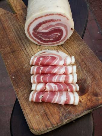 trencher: Pancetta, typical italian roll raw bacon with slices on wood trencher