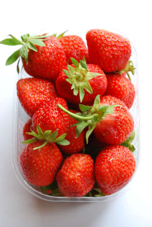 Strawberries in plastic box on white background Stock Photo