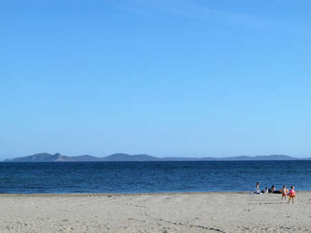 View of an empty beach with Porquerolles island in background, France