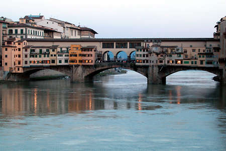 Beautiful Ponte Vecchio bridge at dust, Florence, Italy Stock Photo