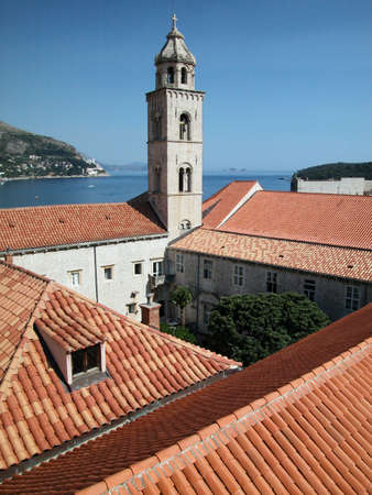 Roofs and bell tower of Dubrovnik fortified town, view from the ancient wall, Croatia