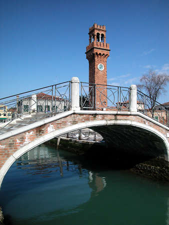 View of bridge and tower bell in Murano, Venice, Italy