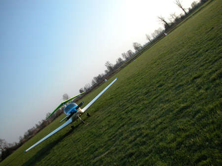 Ultralight airplane ready to fly in a sunny day photo