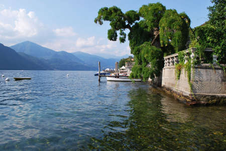Panoramic view of mountains, dock and villa on Orta lake, Italy photo