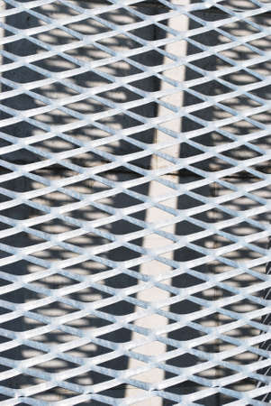Pattern of metal grid as a background Stock Photo