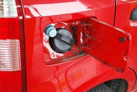 methane: Ecologic methane red car fueling detail Stock Photo