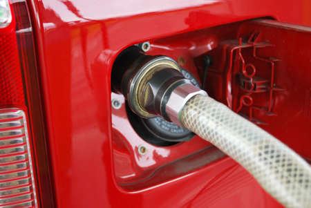 Ecologic methane red car fueling detail Stock Photo