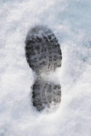 Footprint on the snow in wintertime photo