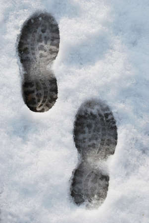 Footprints on the snow in wintertime