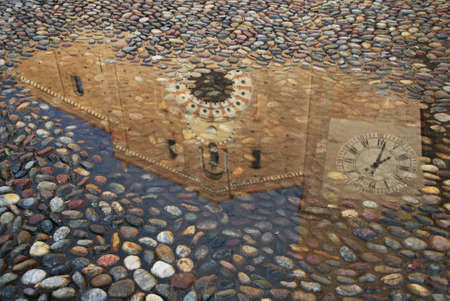 Magic reflection of a church in a puddle, Lodi, Italy