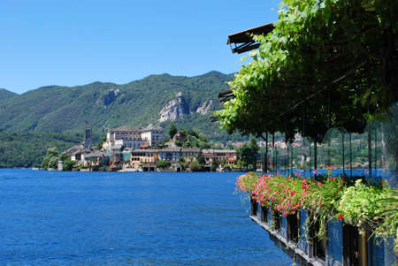Orta lake with Orta San Giulio island in a sunny day, Piedmont, Italy photo