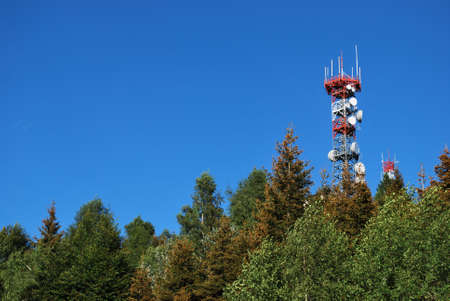Radio antenna communication tower on the top of a mountain, Italy