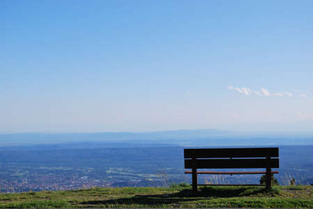Solitary bench with breathtaking panoramic view on Po valley from Bielmonte, Piedmont, Italy, free copy space photo