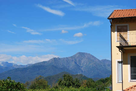 Country house and Alps mountain landscape, Piedmont, Italy Stock Photo