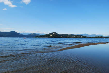 arona: Panoramic view of Maggiore lake from Arona town, Angera castle in background, Italy Stock Photo