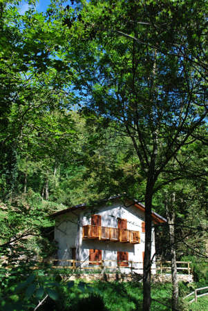 Small country house in the forest, Italy Stock Photo
