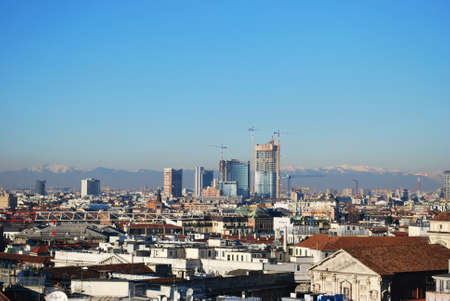 Landscape panoramic view of Milan from Duomo cathedral roof, skyscapers district in background, Lombardy, Italy photo