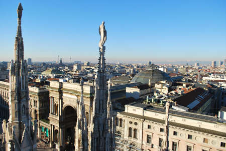 duomo: Landscape panoramic view of Milan from Duomo cathedral roof, Vittorio Emanuele gallery entrance in background, Lombardy, Italy