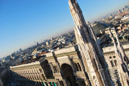 Landscape panoramic view of Milan and Vittorio Emanuele gallery entrance from Duomo cathedral roof, Lombardy, Italy photo
