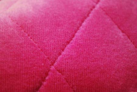 Pink padded velvet fabric texture macro background horizontal