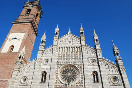 Gothic cathedral facade and bell tower on blue sky, Monza, Lombardy, Italy Stock Photo