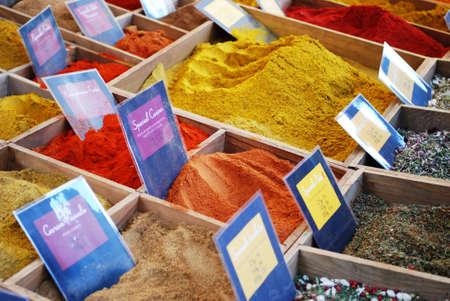 Colorful different spices in the market for sale photo