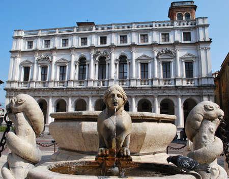 Venetian Contarini fountain, public Library Palace in background, old square, Bergamo, Lombardy, Italy