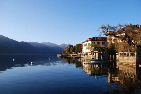 Beautiful ancient houses at sunset on Orta lake, Orta St. Giulio village, Piedmont, Italy photo